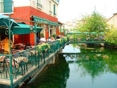 Café à Isle sur la Sorgue. Have shared coffee and dessert under umbrella 2nd from the left over the water. Sweet spot.