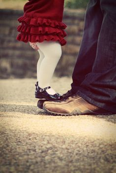 Daddy and daughter dancing..just like I used to do with my Dad..  :)
