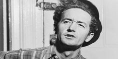 """Woody Guthrie  Woodrow Wilson """"Woody"""" Guthrie was an American singer-songwriter and folk musician whose musical legacy includes hundreds of political, traditional and children's songs, ballads and improvised works"""
