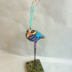 Teal bird with 5 plumes by Judy Whipple SOLD