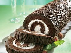 Yule Log - An impressive chocolate cake roll filled with creamy vanilla frosting will keep the home fires burning throughout the holiday season!
