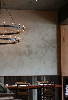 We like the oversize, two-tier iron chandeliers made by Oakland-based blacksmith John Sarriugarte of Form and Reform for Camino Restaurant in Oakland; contact Sarriugarte directly for information. Foyer Chandelier, Industrial Chandelier, Chandelier Lighting, Industrial Interiors, Cafe Interiors, Restaurant Interiors, Restaurant Design, Industrial Style, Flat Interior
