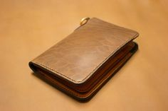 Horween Rich Moc Chromexcel Horse Front leather wallet. Handmade from start to finish. Wickett & Craig Tan Bridle leather inside, with Forest Green Bison leather lining. Solid brass hardware and hand stitched throughout.