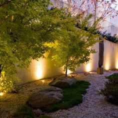 Simple garden design with accent garden lights.  Bit of a rock garden here with a feel of a romantic garden atmosphere.  Just needs a few garden accents we feel and ideally a water feature for a dream garden effect.