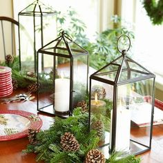 Glass lanterns and evergreen garland makes for easy table decor. Get more ideas for holiday decorating: http://www.bhg.com/christmas/?socsrc=bhgpin092812holidaylanterns