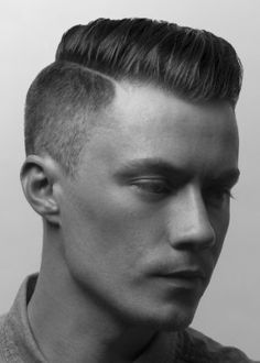 Disconnected undercut with more natural styling, less aggressive fade.