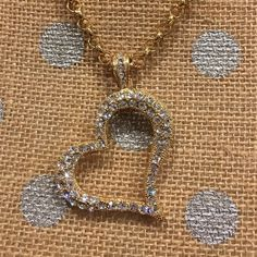 """Faux Diamond heart pendant necklace NWOT. Gold tone metal with faux diamond on 20"""" gold tone chain. The heart pendant hangs at an angle. Clasp is magnetic so you can easier change chain to cord or ribbon. Jewelry Necklaces"""