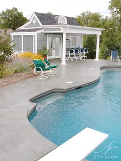 A pleasant addition, the pool house is perfectly proportioned.