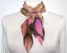 Love the colors, the shapes, the mix of felting and wovens.