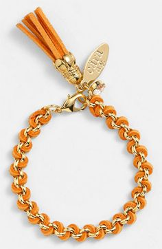Free shipping and returns on Cara Link Bracelet at Nordstrom.com. Textured, tinted faux suede laces a beautifully shined, handcrafted chain bracelet ending with a colorful tassel, logo plate and crystal.