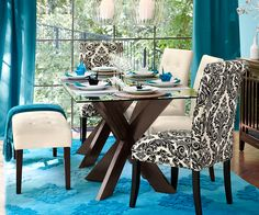 Keep the focus on bold shapes  and colors with a glass table top.