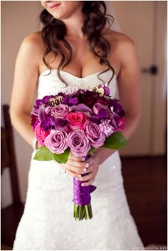 Pink & Purple gorgeous rose Bouquet Wedding colors. It has a heart-shaped wood chip in there with wedding date and initials! And it's pretty :)