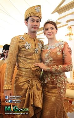 Farid Kamil and Diana Danielle in dlight bronzey brown songket wedding outfit. Suits their fair complexion
