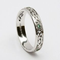 The ring I wear (my wedding band). Not my original wedding ring, but the band I received after 35 years of marriage. It is white gold, done in Celtic style, with tiny diamonds and emeralds. This is stunning!  Lucky lady!  Way to go, her husband! Would love something similar and more manly for Brandon.