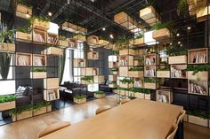 How good are the #interiors of the Home Cafe? Designed by Penda (@chrisprecht_penda), it features recycled steel bars that house modular wooden #cubes filled with #plants.
