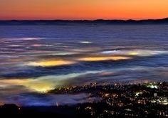 "Stained glass clouds by Chris Morley on Flickr. ""Friday brought a thin layer of fog, spreading out just above the tallest of Vancouver's skyline. A one hour walk to Dog Bump on Seymour Mountain provides a good view from above. Sunset was great and then the urban colours started to bleed through. Hypnotizing to watch. I could of spent the night up there. Of course hiking out by headlamp is always fun too."""