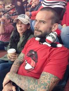 AJ Brooks (Former WWE Diva/Diva's champ AJ Lee).. And Phil Brooks also known as CM Punk!! Hey a sock monkey :)
