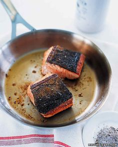 Spiced Pan-Seared Salmon | Sprinkle both sides of salmon fillets with salt, pepper, chili powder, and cinnamon. Heat oil in a large saute pan over medium-high heat. Add salmon, skin side down, and cook until skin is crisp, browned, and releases easily from pan, 3 to 4 minutes. Flip salmon, and cook to desired doneness, 2 to 3 minutes for medium-rare.