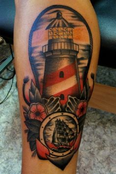 Love this lighthouse tattoo.