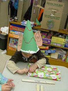 On the day before X-Mas break, we always wrap up our parent gifts to take home. Before we wrap our gifts, we make these little elf hats. So cute watching Santa's little elves wrapping up their gifts!!