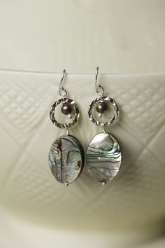 These unique dangle abalone and pearl silver hoop earrings for women use natural abalone and pearl with sterling silver earring wires. Sterling silver earwires (nickel and lead-safe) Sterling hoops (