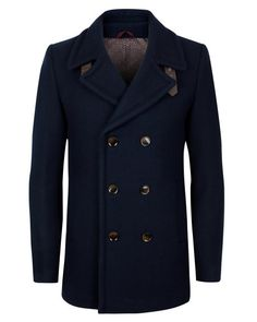 This double breasted wool coat would be perfect for exploring city streets in winter.