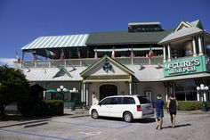 The facade of an Irish pub. The green and white colors are very characteristic.
