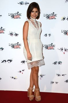 Miroslava Mira Duma at the Lancome party... wearing a little white dress with lace and tulle details