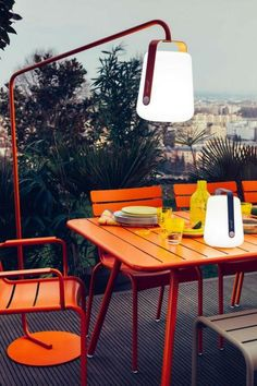 Elegant, modern, practical outdoor furniture by Fermob. Luxembourg Table and Chairs with new Balad Lamp outdoor lighting with stand. Outdoor Table Lamps, Balcony Table And Chairs, Room Chairs, Modern Outdoor Furniture, Modern Patio, Vintage Furniture, Design Shop, Spray Paint Furniture, Painting Furniture