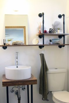 LOVE the flange-and-pipe shelves!  Charlotte & Steve's Handmade Home House Tour | Apartment Therapy