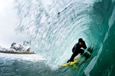 Malloy tucks into the barrel of a wave. (Photos by Chris Burkard/Caters News) - http://www.PaulFDavis.com/success-speaker (info@PaulFDavis.com) and life coach for peak performance, victory, overcoming adversity and living your dreams fearlessly!