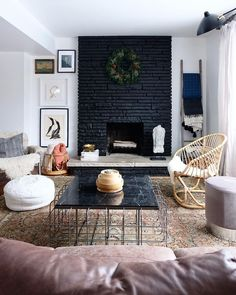 Black painted fireplace with natural stone hearth and simple wreath, Love how dramatic it is! Black painted fireplace with natural stone hearth and simple wreath, Love how dramatic it is! Black Brick Fireplace, Painted Stone Fireplace, Paint Fireplace, Brick Fireplace Makeover, Fireplace Design, Fireplace Mantels, Black Brick Wall, Painted Brick Walls, Faux Fireplace