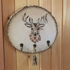 The Whimsical Deer Head hook plaque is a great addition for anyone who loves rustic decor. Use the hooks for your keys, jewelry, scarves or whatever you like!