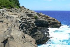 China Wall/Spitting Cave - East from Honolulu and before Hanauma Bay, waves thunder into a layered shoreline cliff known as the China Wall.