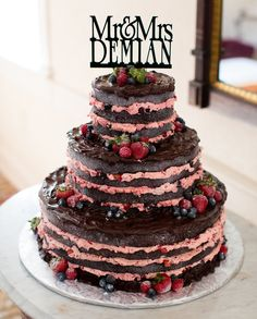 Tall chocolate naked cake with berry filling and chocolate frosting