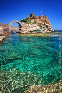 Old stone bridge and Lighthouse in Andros by Antonis Lemonakis on 500px