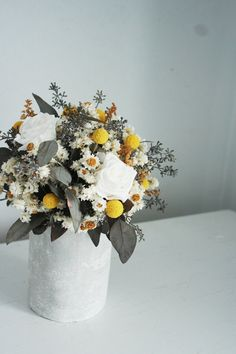 Field harvest. Natural dried flower arrangement in cement vase.. $75.00, via Etsy.
