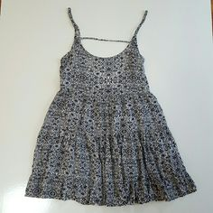 Brandy melville jada blue white Adorable Brandy Melville jada dress in blue and white with wonderful details including flowers leaves swirls circles and dots. Rare and hard to find print, in great condition with no snags stains or tears. Brandy Melville Dresses