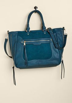 Tasks All Over Town Bag in Teal - With errands to achieve in various parts of the city, what's a gal to do? Get organized and grab this faux-suede bag, that's what! A chic companion with its handy front pocket, faux-leather accents, and zipped sides for added structure, this teal satchel expertly aids in every part of your mission.