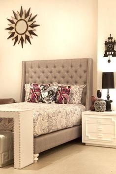 bedroom with sunburst mirror