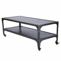 """Stainless steel coffee table with a bottom display shelf and rivet accents.  Product: Coffee tableConstruction Material: Stainless steelColor: Black    Features: Industrial styleFour casters provide smooth portability Dimensions: 18.5"""" H x 47.3"""" W x 28.8"""" D"""
