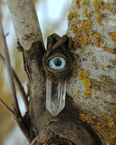 Mossy root wrapped quartz crystal ~ Dragon eye pendant.