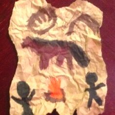 """Paleolithic Era Cave Drawings My 6th graders painted these on """"Cave Day"""", in the dark so they could really feel what it would have been like.  They got to bring in a flashlight to simulate the light from fire that early humans might have used.  The kids had a blast."""