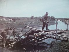 Wermacht soldier on a ruined bridge, Oskol river, eastern front 1942 - pin by Paolo Marzioli