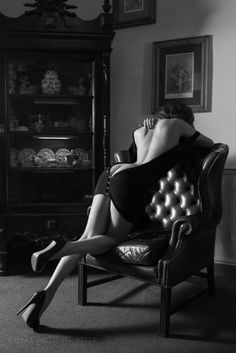 The curves on the woman are enhanced in a sensual way as the dress invites a provocative sense while the room gives it a flair of elegance and class.