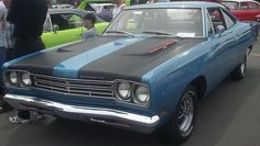 1969 Plymouth Roadrunner... similar to my dads but his is turquoise with glossy black racing stripes!!!