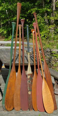 Antique paddles... Painted and stained.