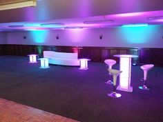 Lighted lounge & cocktail tables for a holiday party.