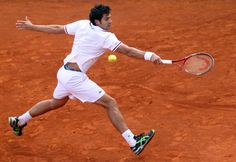 Italy's Simone Bolelli returns the ball to his Croatian opponent Marin Cilic during their Monte-Carlo ATP Masters Series tournament tennis match, on April 17, 2012 in Monaco.