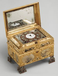 Nécessaire incorporating an automaton watch, ca. 1770–72  Signed by James Cox (English, ca. 1723–1800)  Case: moss agate, mounted in gold and set with diamonds, rubies, and emeralds; silver; and mirror glass; dial: white enamel, with frame pavé set with paste jewels